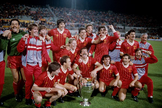 Liverpool players and coaching staff celebrate with the European